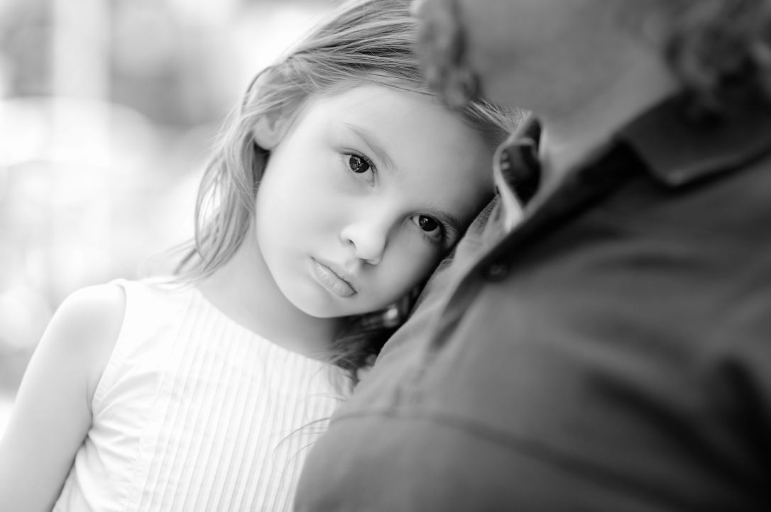 43192349 - black and white photo of sad little girl with her father